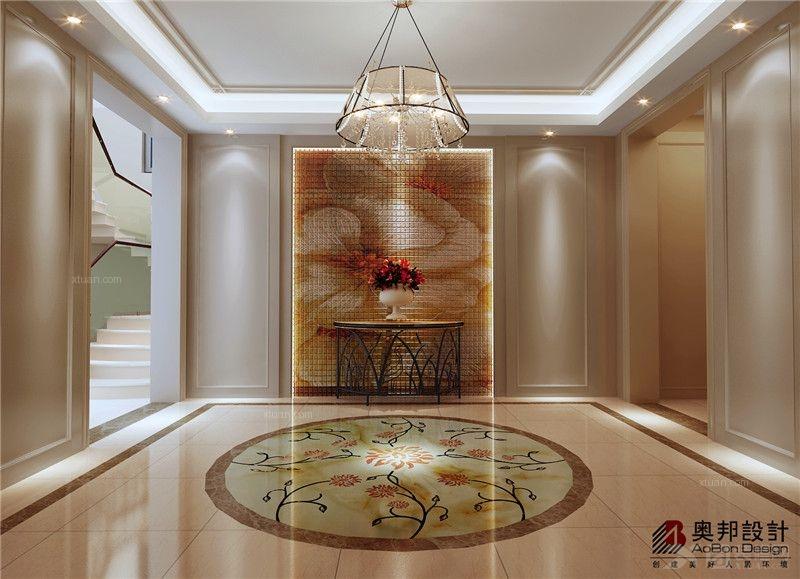 门厅地板的圆形花纹图案与玄关壁画及桌上的大红花朵