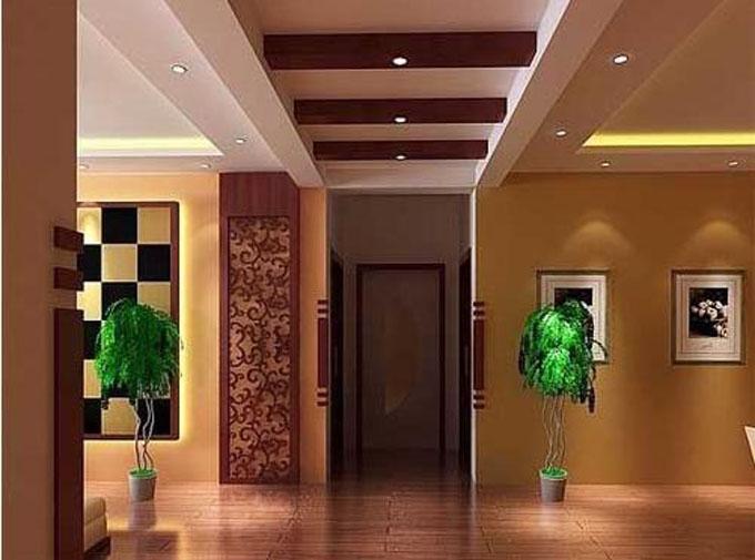 设计理念:客厅是家居空间最大也是最重要的部分,在这个开阔的空间里,吊顶的造型设计不容小觑。客厅与餐厅是一个整体的开阔空间,设计者虽然用同一平面的吊顶,却用简单的几何图案边框将其巧妙分隔,使两个功能区域在视觉空间相对独立。地面和墙面的白色一直延伸到头顶这片天花板上,纯净统一的白色给人通透之感,玄关、客厅吊顶通过不同平面的效果图做出空间层次感。温馨淡雅的客厅空间用白色和粉色相搭配,平面吊顶只在边角处做暗灯效果,简单却漂亮得恰到好处。用内置等和暗灯设计没有直射灯光的强烈光线,营造出浪漫温馨的家居氛围,凹凸式吊顶