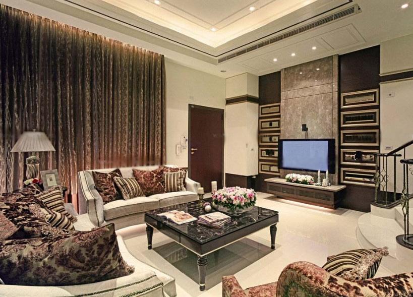 设计理念:在客厅装修效果图里,其华丽而又大器的客厅电视背景墙设计