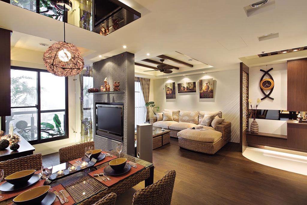 主人钟爱的巴厘岛风格,在设计师作品中看到了现代手法的创新诠释。不大的空间营造出一派悠闲惬意。于是设计师将空间分为公共与私人两大区域,公用空间将玄关、客厅、餐厅、厨房、阅读区予以整合,一道特殊漆料的落地电视墙巧妙地区隔客餐厅、而餐厅两旁又分别延伸出厨房与阅读区,为开放格局制造视觉层次,生活动线便捷而流畅。
